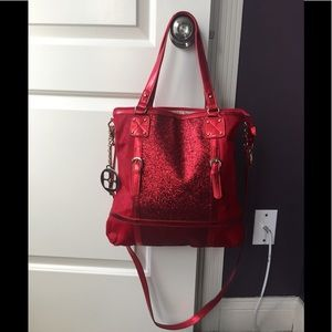 IMAN red shimmer and fur handbag